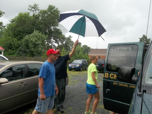 It started to rain as they were leaving and Zel held the umbrella for the ladies!