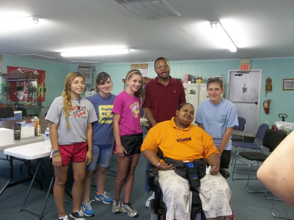Our newest member D.J. with Amy and some of this week's wonderful Youthworks volunteers - work on girls with your bad selves!