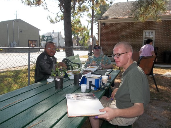 """Today was so nice out we decided to have a little picnic outside.  Matt says.....""""We are eating our lunch from the Market Street Grill and can't sit still!'""""    Brandon says.... they are trying to look cool!"""