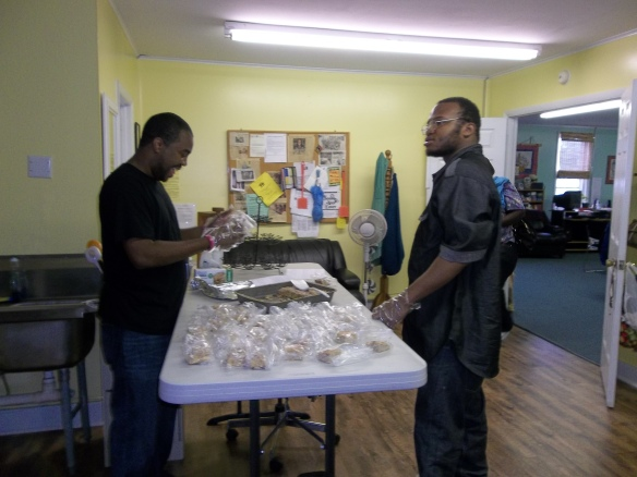 Steve and DJ getting baked goods ready for the Dash of Hope Community Meal. The men in black don't take no slack!!