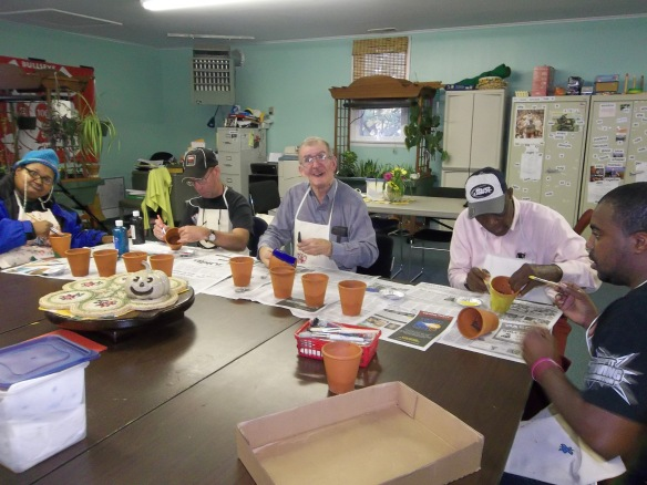 The group is painting plant pots for the fall Kiwanis Craft Fair - paint on people, paint on!