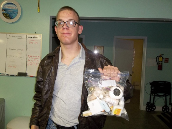 Brandon and some shampoos and soap we donated to the Coalition Against Domestic Violence.