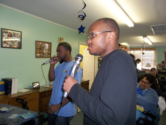 Steve and DJ practicing to be rock stars during Brandon's karaoke themed birthday party!