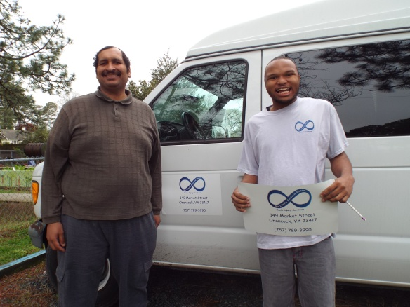 DJ & Zel installing our new van signs, yippee!!