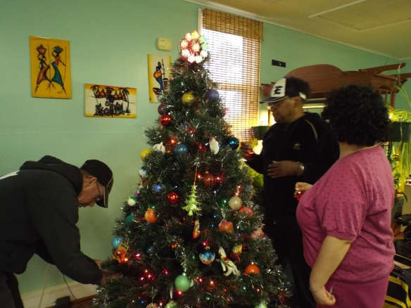 David, Beth, and John putting up Christmas decorations!