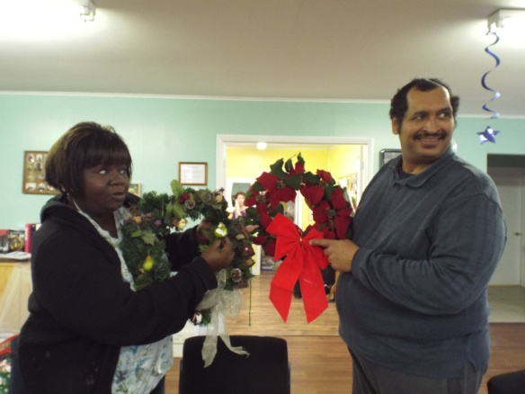 Sherry and Zel holding up a  wreath!