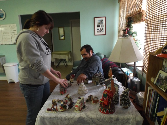 Brittney and Zel putting up the snow village.