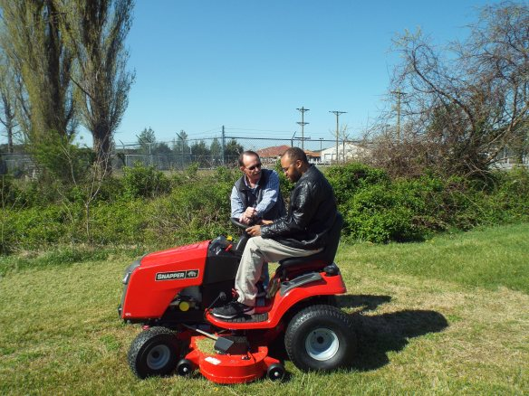 DJ learning to use our new mower. Mow DJ mow! Don't miss a spot!